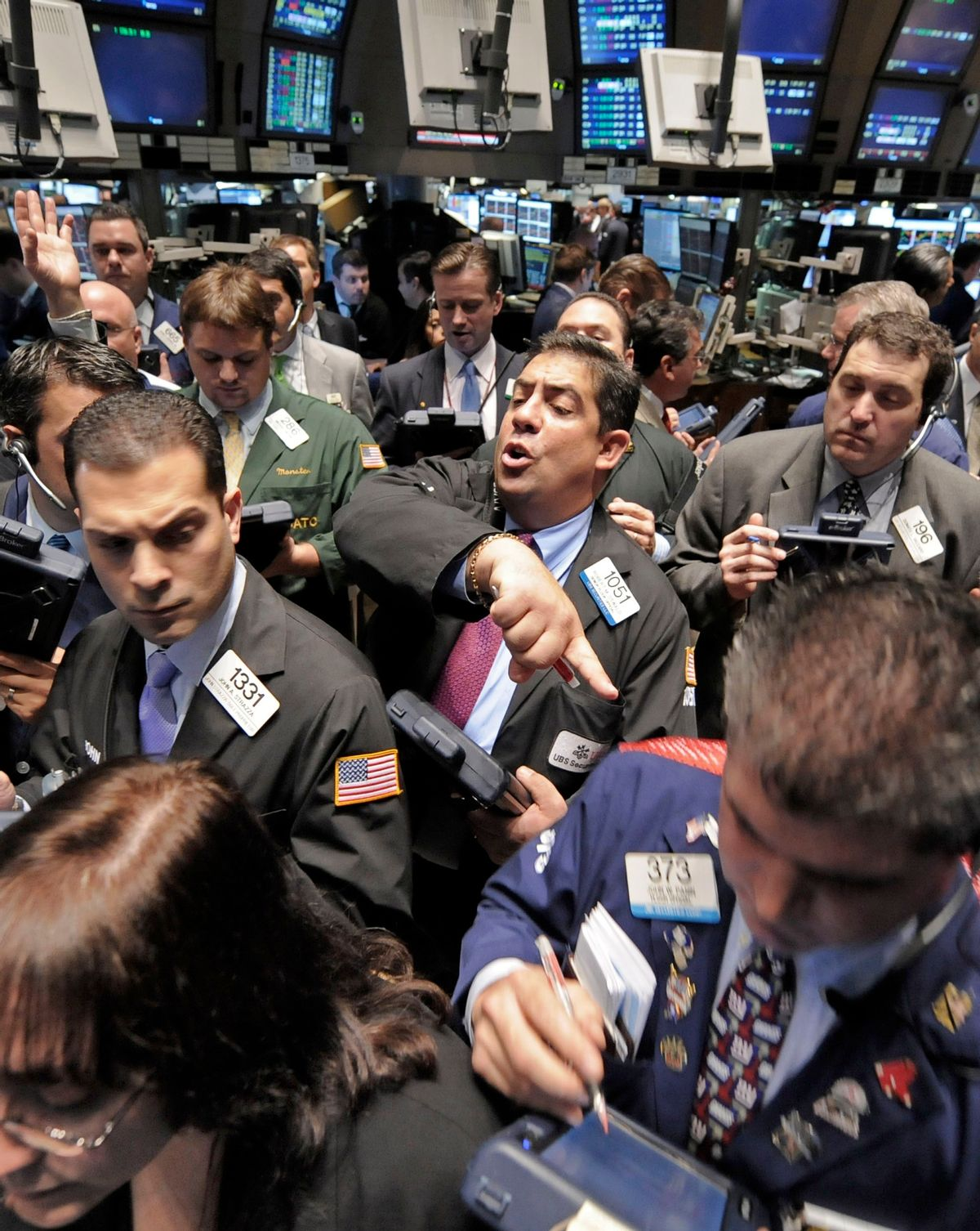 Traders gather at the post that handles General Motors on the floor of the New York Stock Exchange Friday, Nov. 7, 2008. (AP Photo/Richard Drew) (AP)