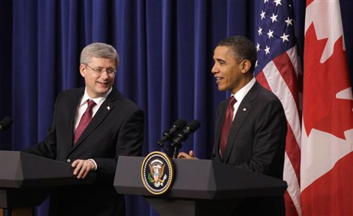 President Barack Obama and Canada's Prime Minister Stephen Harper take part in a joint news conference, Friday, Feb. 4, 2011, in the Eisenhower Executive Office Building on the White House complex in Washington. (AP Photo/Charles Dharapak) (AP)