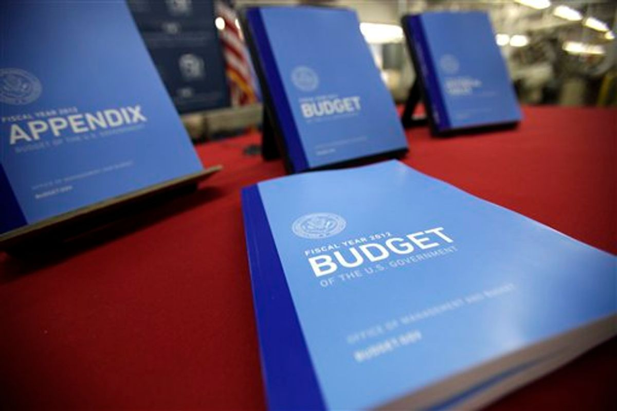 In this photo taken Feb. 10, 2011, the 2012 budget is on display at the U.S. Government Printing Office at Washington. President Barack Obama Obama will send his 2012 budget proposal to Congress on Monday, Feb. 14.  According to an Office of Management and Budget summary obtained by The Associated Press, the administration will propose more than $1 trillion in deficit reduction over the next decade with two-thirds of that amount coming from spending cuts.  (AP Photo/Jacquelyn Martin) (AP)