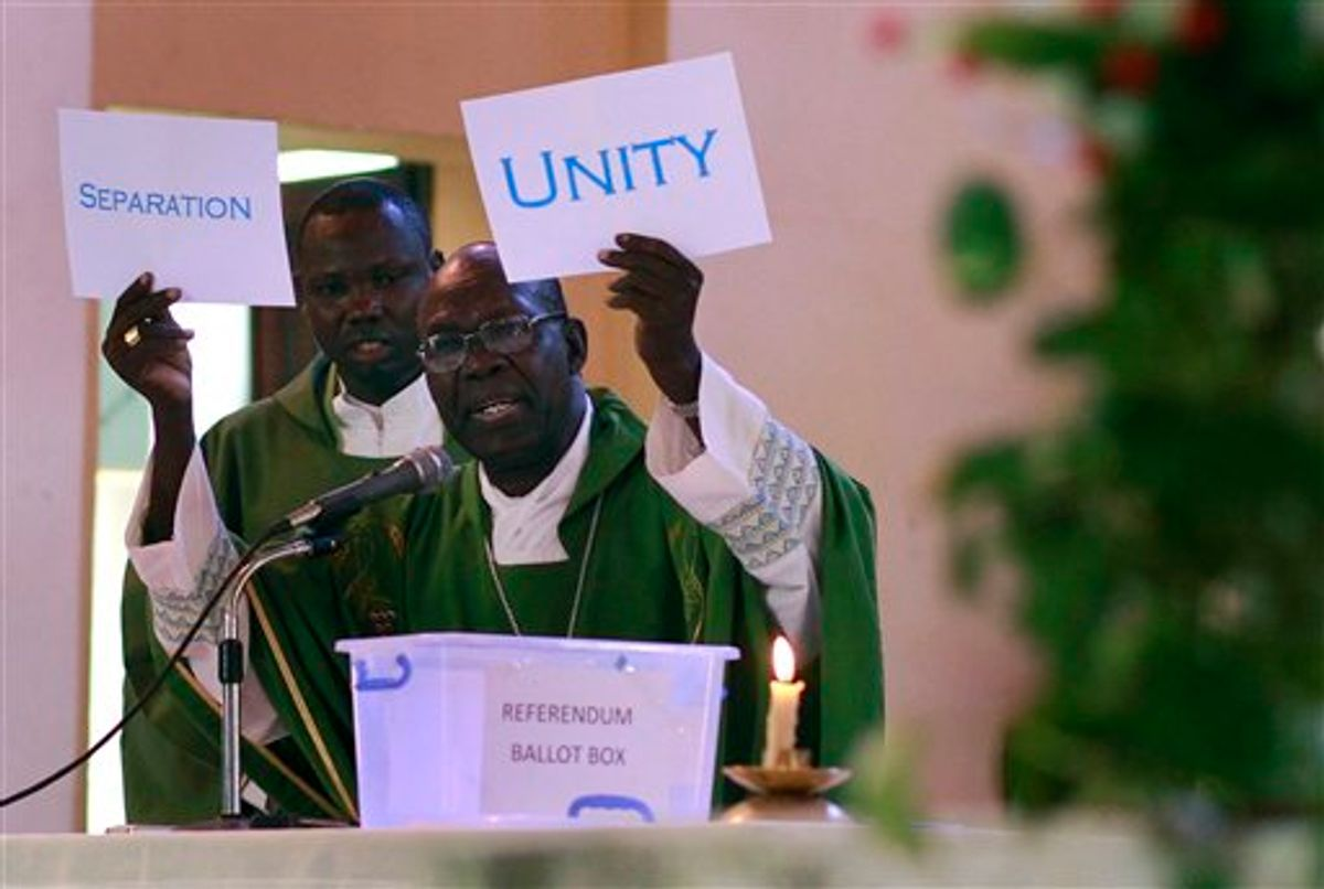 South Sudanese Catholic Archbishop Paulino Lukudu holds up mock ballots during a service attended by President Salva Kiir in  Juba, Southern Sudan, Sunday  Jan. 16, 2011. The Southern Sudan's president on Sunday offered a prayer of forgiveness for northern Sudan and the killings that occurred during a two-decade civil war, as the first results from a weeklong independence referendum showed an overwhelming vote for secession. About four million  Southern Sudanese voters cast their ballots  in a weeklong referendum on independence that is expected to split Africa's largest nation in two.(AP Photo/Jerome Delay)  (AP)