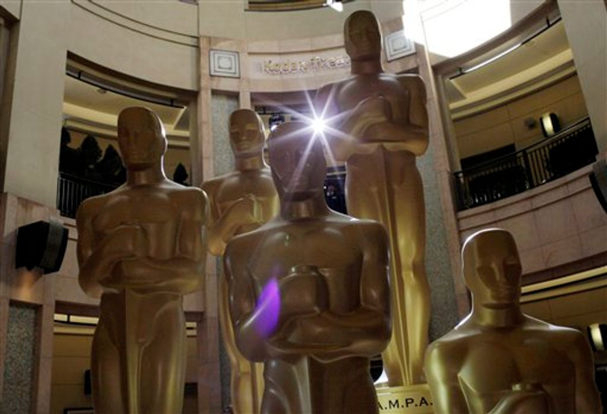 Oscar statues stand in front of the Kodak Theatre as preparations for the 83rd Academy Awards continue in Los Angeles, Saturday, Feb. 26, 2011. (AP Photo/Jae C. Hong) (AP)