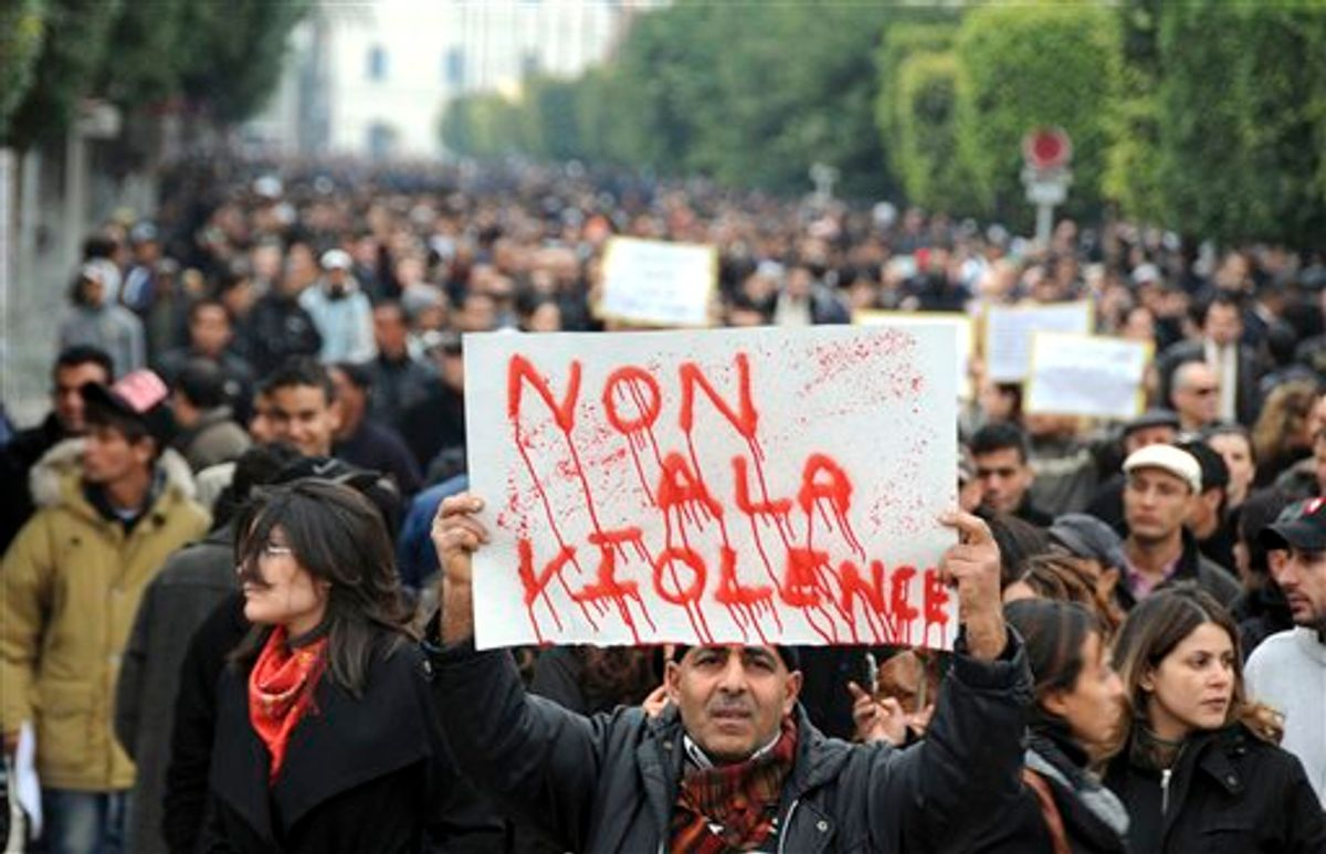 """Protestors supporting the government and opposed to strikes demonstrate in Tunis, Tuesday Jan. 25, 2011. Tunisia's so-called """"Jasmine Revolution"""" has sparked scattered protests and civil disobedience in the Middle East and North Africa, and much of the world is watching to see how the birth pangs of Tunisian democracy play out. Poster reads: No to the violence. (AP Photo/Hassene Dridi)  (AP)"""