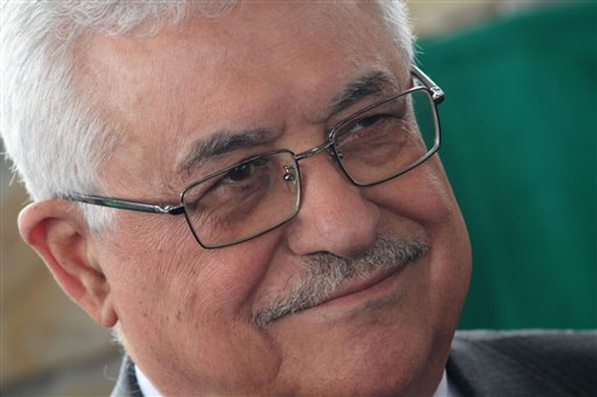 Palestinian President Mahmoud Abbas looks on during a ceremony to set the corner stone of the future Palestinian Embassy in Brasilia, Brazil, Friday, Dec. 31, 2010. Abbas is on a three-day official visit to Brazil. (AP Photo/Eraldo Peres).  (AP)