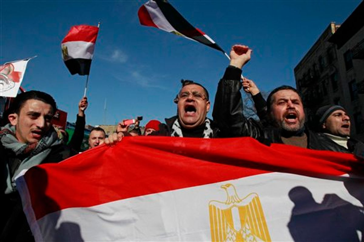People celebrate after Egypt's President Hosni Mubarak resigned from office Friday, Feb. 11, 2011 in the Queens borough of New York. Mubarak resigned as president after 29 years in power. (AP Photo/Frank Franklin II) (AP)