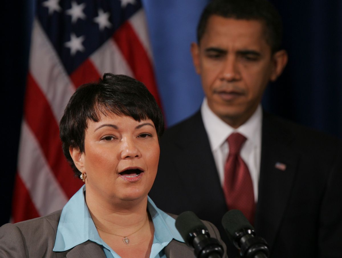President-elect Barack Obama, right, listens EPA administrator nominee Lisa Jackson addresses the media at a news conference in Chicago, Monday, Dec. 15, 2008. (AP Photo) (Associated Press)