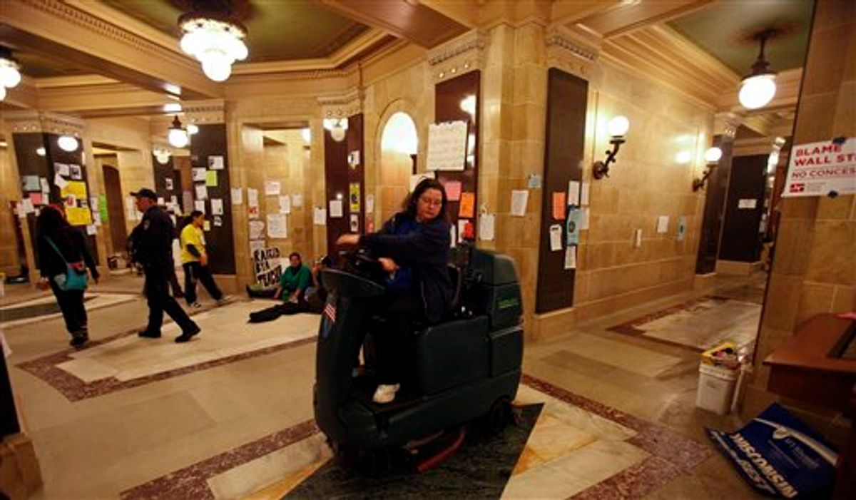 A custodian washes the floor of the at the state Capitol in Madison, Wis., Sunday, Feb. 27, 2011., on the 13th day of protests over the governor's proposed budget. (AP Photo/Andy Manis)          (AP)