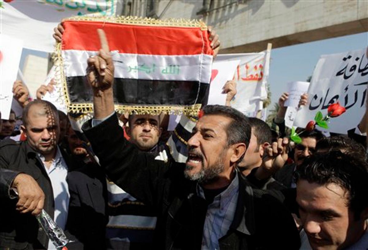 Protesters chant anti-government slogans during a demonstration in Baghdad, Iraq, Monday, Feb. 14, 2011. Hundreds of Iraqis rallied in central Baghdad against corruption and the lack of government services that have plagued this country for years.  (AP Photo/Karim Kadim) (AP)