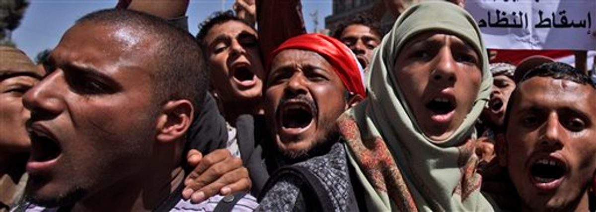 Anti-government protestors chant slogans during a demonstration demanding the resignation of Yemeni President Ali Abdullah Saleh, in Sanaa, Yemen, Thursday, Feb. 24, 2011. Yemen's president said Wednesday he had ordered his security services to protect protesters, stop all clashes and prevent direct confrontation between government supporters and opponents. (AP Photo/Muhammed Muheisen) (AP)