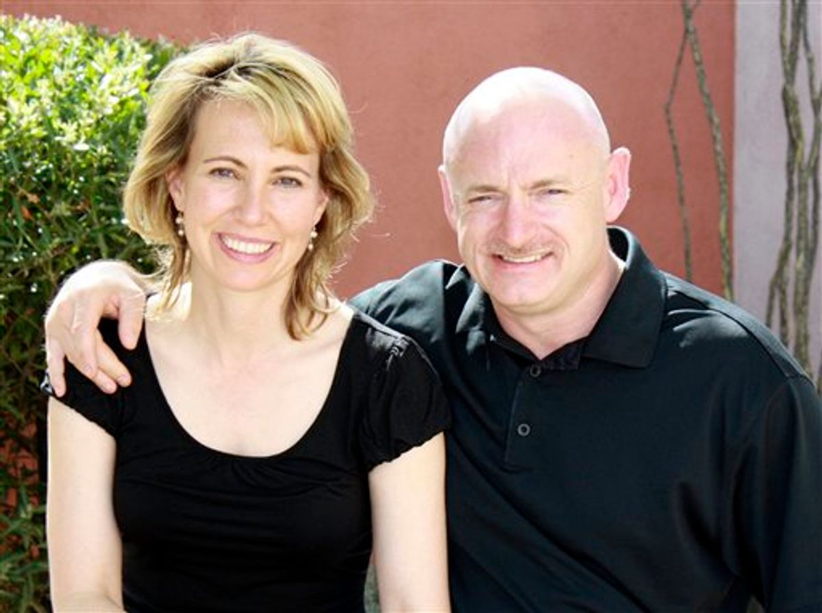 """FILE - In this undated file photo provided by the office of Rep. Gabrielle Giffords, Giffords, left, is shown with her husband, NASA astronaut Mark Kelly. There are hints that astronaut Mark Kelly will take a shuttle into space in April. That would mean leaving his wounded wife, Rep. Gabrielle Giffords, to continue her rehab work without him for at least a few weeks. Scott Kelly, also an astronaut, said his brother would decide """"fairly soon"""" whether to fly the space shuttle mission in April. (AP Photo/Office of Rep. Gabrielle Giffords, File)  (AP)"""