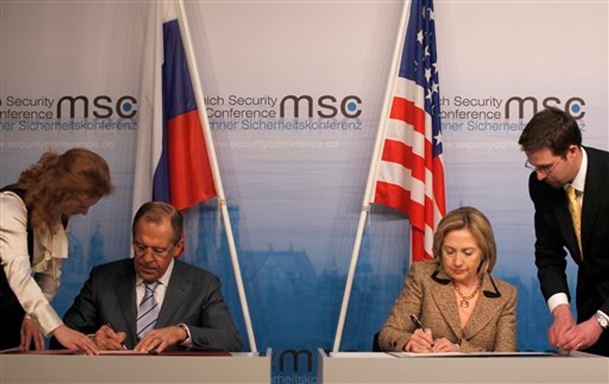 US Secretary of State Hillary Rodham Clinton, right, and Russia's Foreign Minister Sergey Lavrov finalize the New START treaty  during the Conference on Security Policy in Munich, Germany, Saturday, Feb. 5, 2011.   (AP Photo/Frank Augstein) (AP)