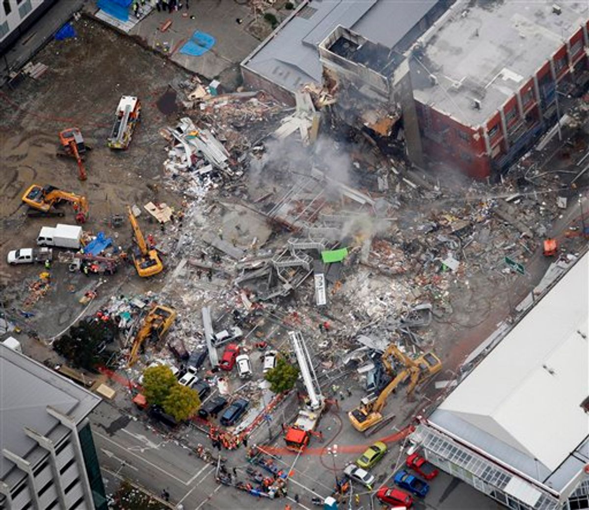 An aerial view of emergency services people working at the ruined CTV building in central in Christchurch, New Zealand, Wednesday, Feb. 23, 2011. Search teams used their bare hands, dogs, heavy cranes and earth movers Wednesday to pull survivors from the rubble of Tuesday's powerful earthquake. (AP Photo/Sarah Ivey) AUSTRALIA OUT, NEW ZEALAND OUT  (AP)