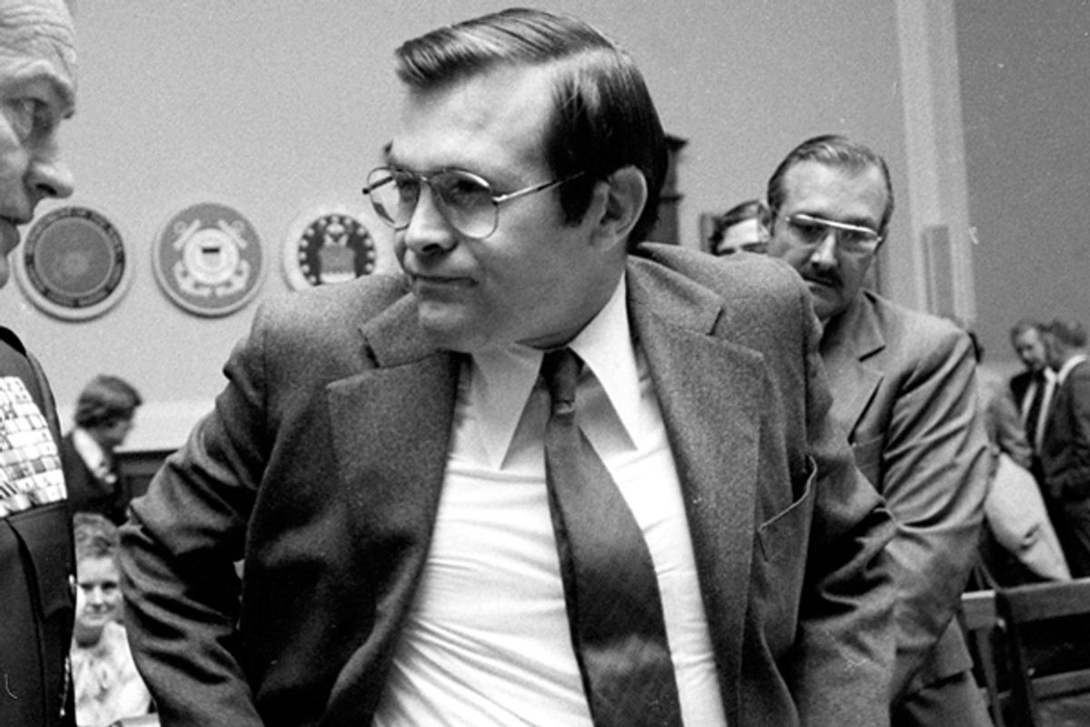 Former U.S. Seretary of Defense Donald Rumsfeld chats with Joint Chiefs of Staff Chairman Gen. George Brown prior to their testifying before the House Armed Services Committee in Washington in this Jan. 28, 1976 file photo