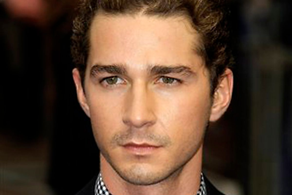 Actor Shia LaBeouf poses for photographers as he arrives for the UK premiere of the film 'Transformers: Revenge of the Fallen' at a cinema in London, Monday June 15, 2009.  (AP Photo/Matt Dunham) (Matt Dunham)