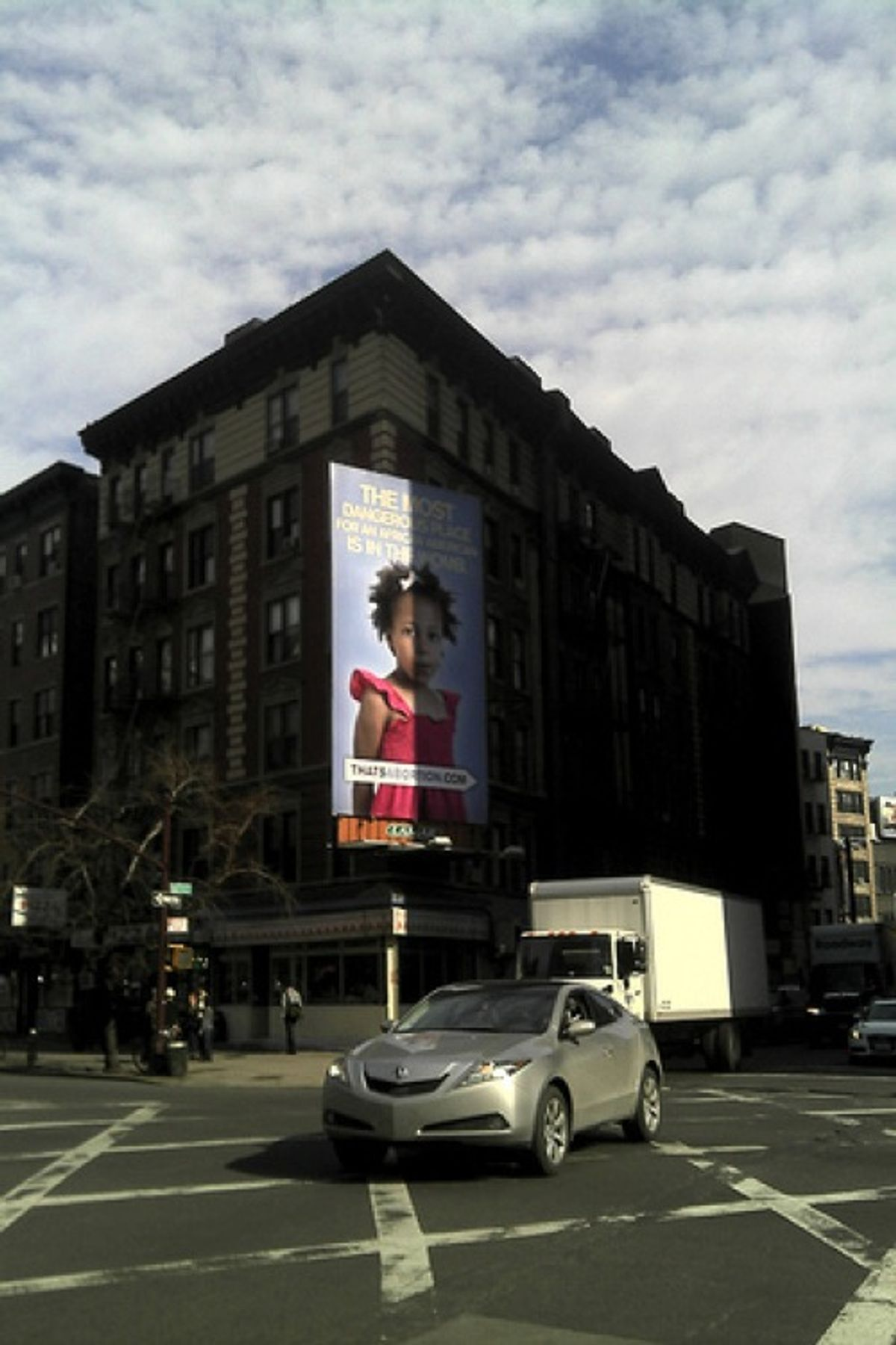 The anti-abortion billboard stands at the corner of 6th street in SoHo