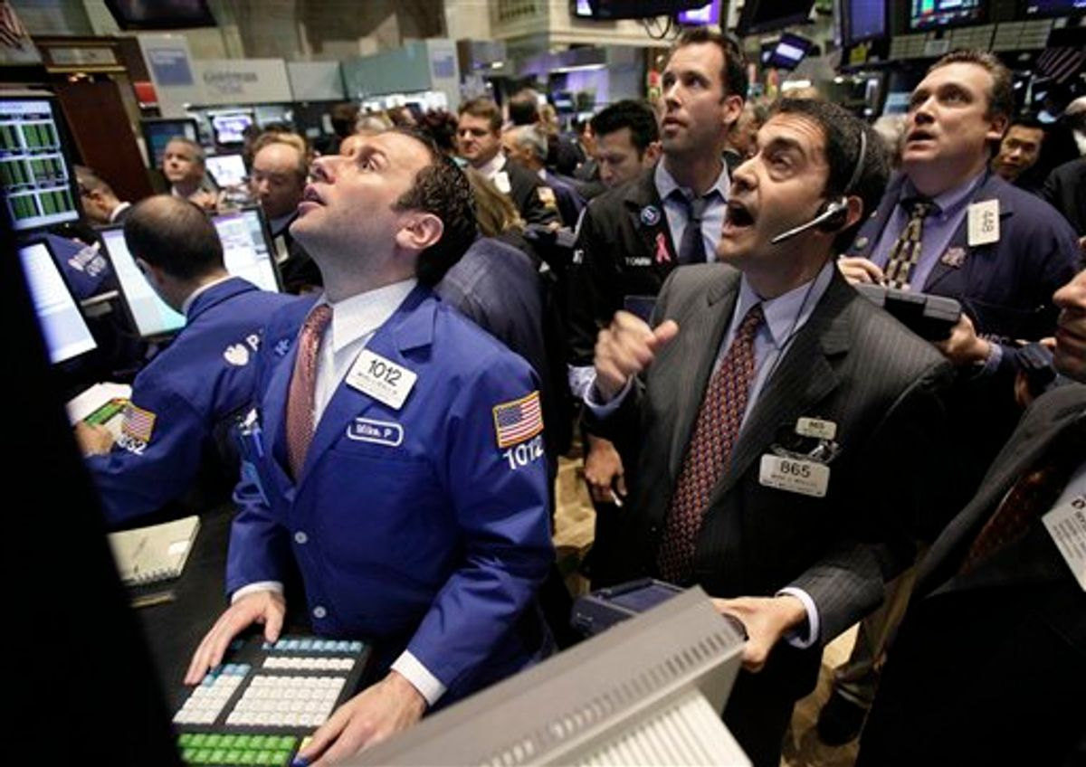 FILE - In this May 25, 2010 file photo, specialist Michael Pistillo, left, and traders work on the floor of the New York Stock Exchange. Everyday investors are finally inching back into the stock market. But are they too late?  (AP Photo/Richard Drew, file) (AP)