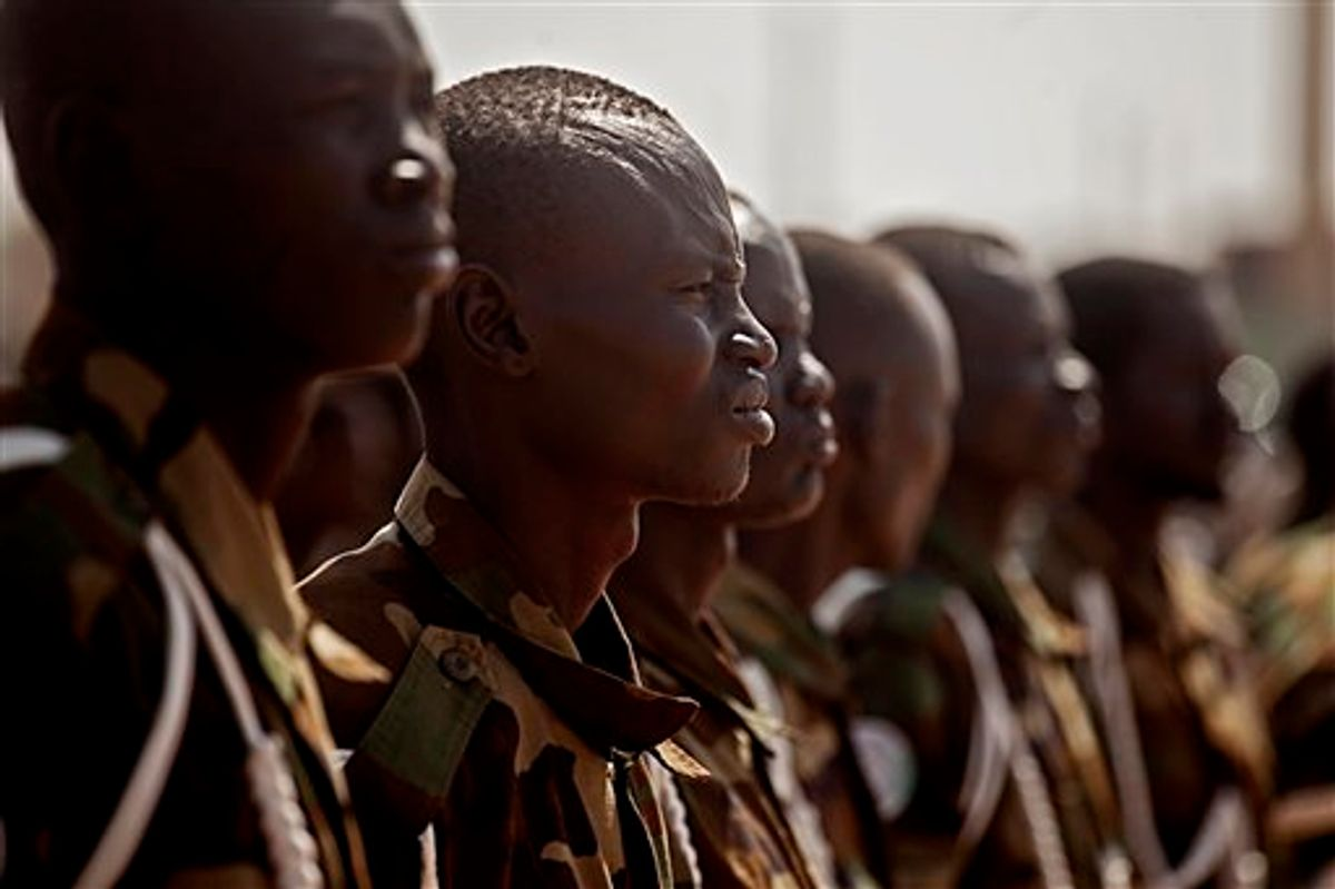 Southern Sudanese soldiers await the arrival of Malawi President Bingu wa Mutharika at the airport in the southern Sudanese capital of Juba on Wed. Jan. 26, 2011. Mutharika is the current chair of the African Union, a body that has been deeply engaged with southern Sudan up to and through its recent referendum on independence. Mutharika is the first head of state to visit southern Sudan since the referendum concluded on January 15, 2011. Preliminary results indicate that southerners voted heavily for independence. (AP Photo/Pete Muller)  (AP)