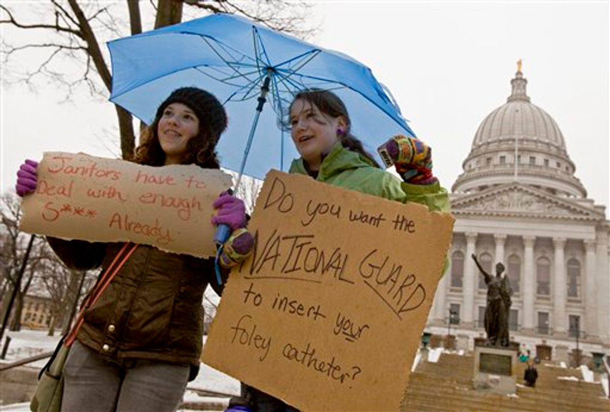 Jane Moran, left, 14, and Emma Rankin-Utevsky, 14, protest outside of at the State Capitol in Madison, Wis., Sunday, Feb. 20, 2011. Opponents to the governor's bill to eliminate collective bargaining rights for many state workers are on their sixth day of protesting. (AP Photo/Andy Manis)  (AP)