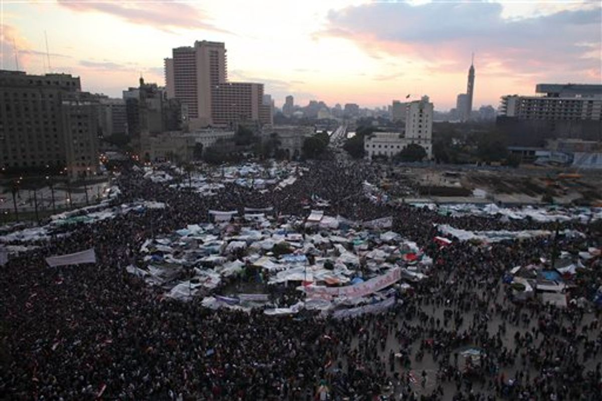 """Anti-government protesters demonstrate in Tahrir Square in Cairo, Egypt, Thursday, Feb. 10, 2011. President Hosni Mubarak refused to step down or leave the country and instead handed his powers to his vice president Thursday, remaining president and ensuring regime control over the reform process, which stunned protesters demanding his ouster, who waved their shoes in contempt and shouted, """"Leave, leave, leave."""" (AP Photo/Tara Todras-Whitehill) (AP)"""