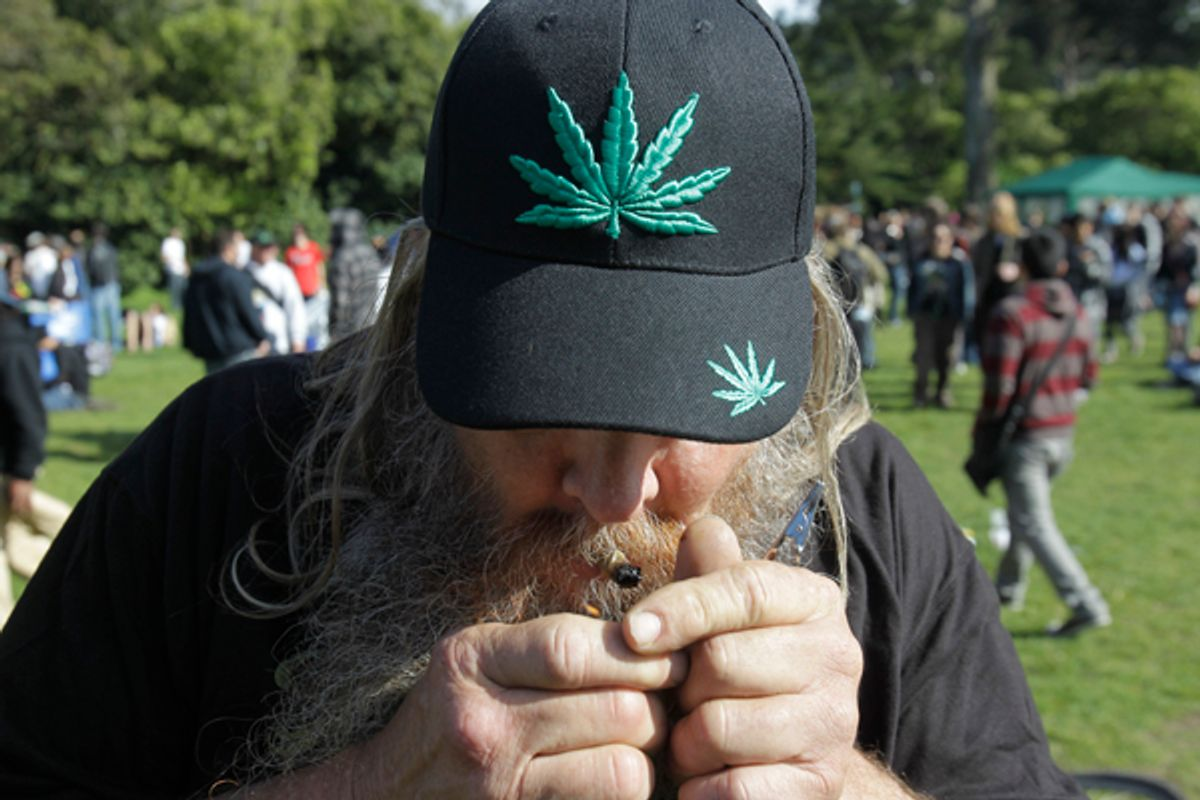 """A man smokes marijuana at Golden Gate Park in San Francisco, Tuesday, April 20, 2010. Marijuana legalization advocates lit up across the country during the annual observance of 4/20, the celebration-cum-mass civil disobedience derived from """"420"""" - insider shorthand for cannabis consumption. (AP Photo/Marcio Jose Sanchez) (Marcio Jose Sanchez)"""