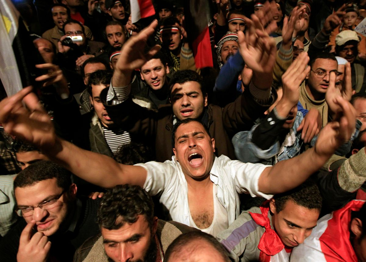 """Opposition supporters shout in their stronghold of Tahrir Square, in Cairo February 10, 2011. President Hosni Mubarak provoked rage on Egypt's streets on Thursday when he said he would hand powers to his deputy but disappointed protesters who had been expecting him to step down altogether after two weeks of unrest. """"Leave! Leave!"""" chanted thousands who had gathered in Cairo's Tahrir Square in anticipation that a televised speech would be the moment their demands for an end to Mubarak's 30 years of authoritarian, one-man rule were met.  REUTERS/Goran Tomasevic (EGYPT - Tags: POLITICS CIVIL UNREST)       (© Goran Tomasevic / Reuters)"""
