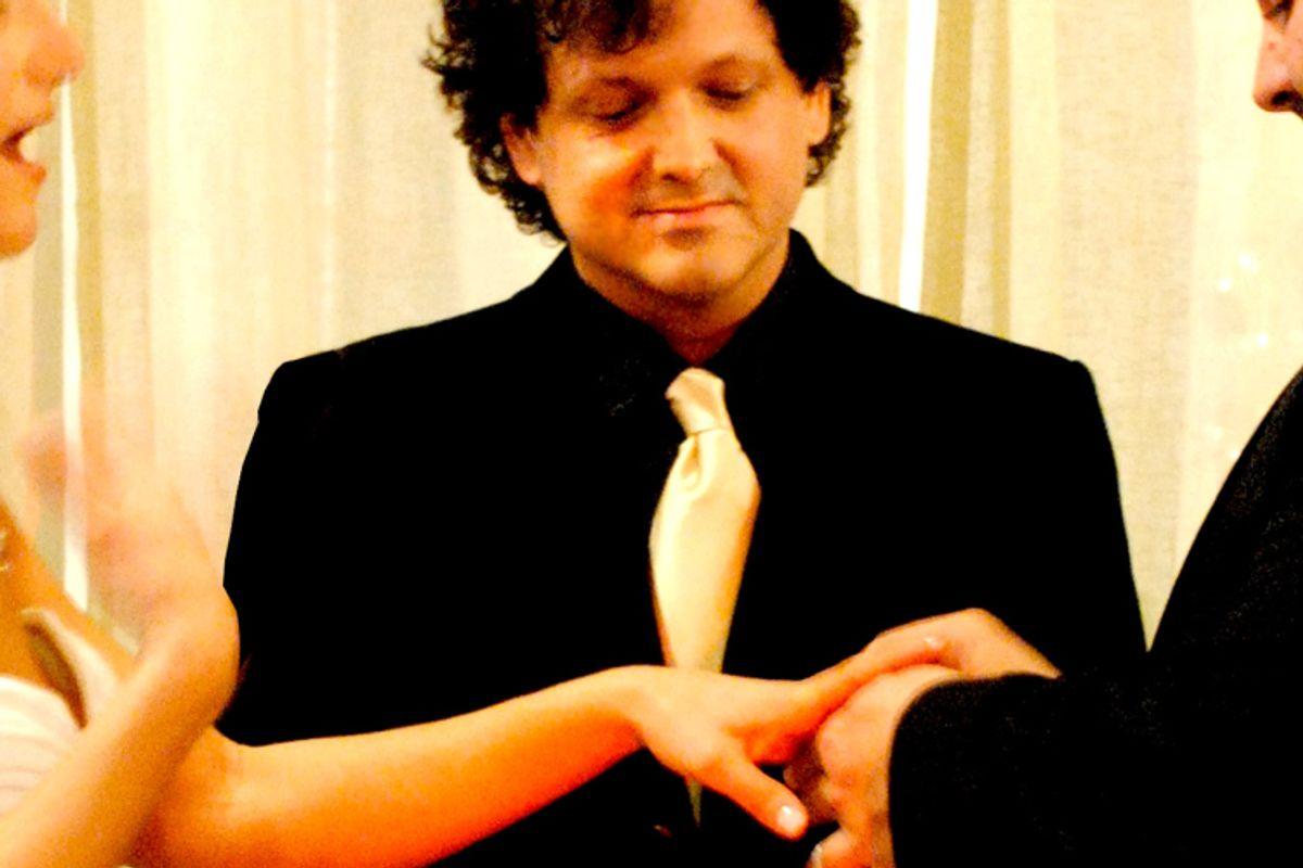 The author, center, performing a wedding ceremony.