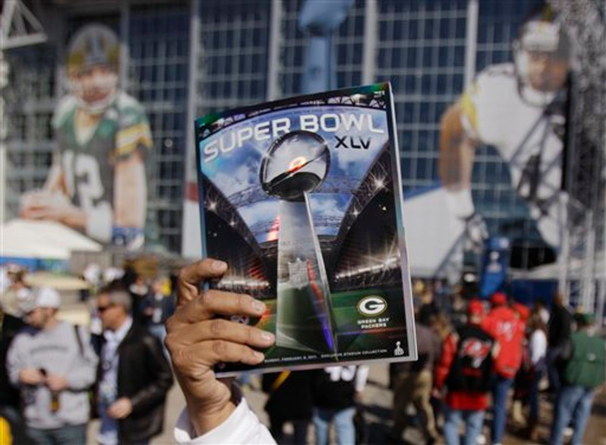 A program is sold outside Cowboy Stadium before the NFL football Super Bowl XLV game between the Green Bay Packers and the Pittsburgh Steelers Sunday, Feb. 6, 2011, in Arlington, Texas. (AP Photo/Matt Slocum)  (AP)