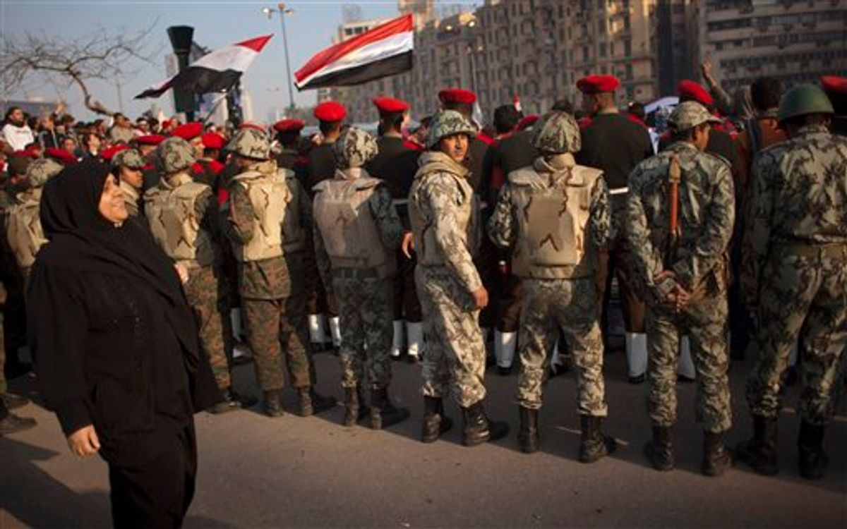 Egyptian army military police and army soldiers form a line to clear protesters from the street and enable vehicles to pass in Tahrir Square in downtown Cairo, Egypt, Sunday, Feb. 13, 2011. Egypt's military is taking down the makeshift tents of protesters who camped out on Tahrir Square in an effort to allow traffic and normal life to return to central Cairo. There were a few verbal altercations between soldiers and protesters Sunday morning as the tents were removed, but the process was generally peaceful.  (AP Photo/Emilio Morenatti) (AP)