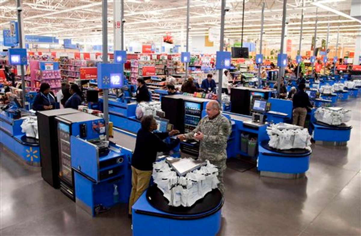 In this photo taken Dec. 15, 2010, the check-out inside a Wal-Mart store in Alexandria, Va., is shown. The battleground for the biggest fight in retailing today is being played out along this suburban highway. Going head-to-head: Wal-Mart against everyone else.  (AP Photo)  (AP)