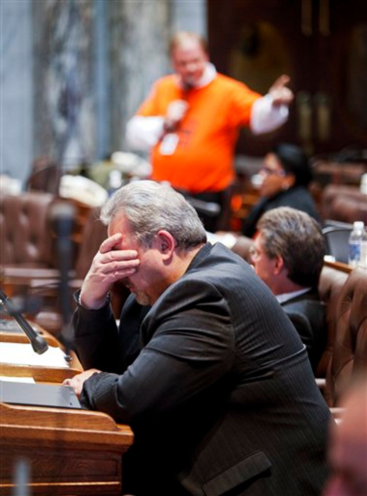 Wisconsin Rep. Mark Honadel, R-South Milwaukee, rubs his eyes during the 23rd hour of debate in the Assembly at the state Capitol in Madison, Wis., Wednesday, Feb. 23, 2011. Opponents to the governor's bill to eliminate collective bargaining rights for many state workers are on their ninth day of protests at the Capitol. (AP Photo/Andy Manis)  (AP)
