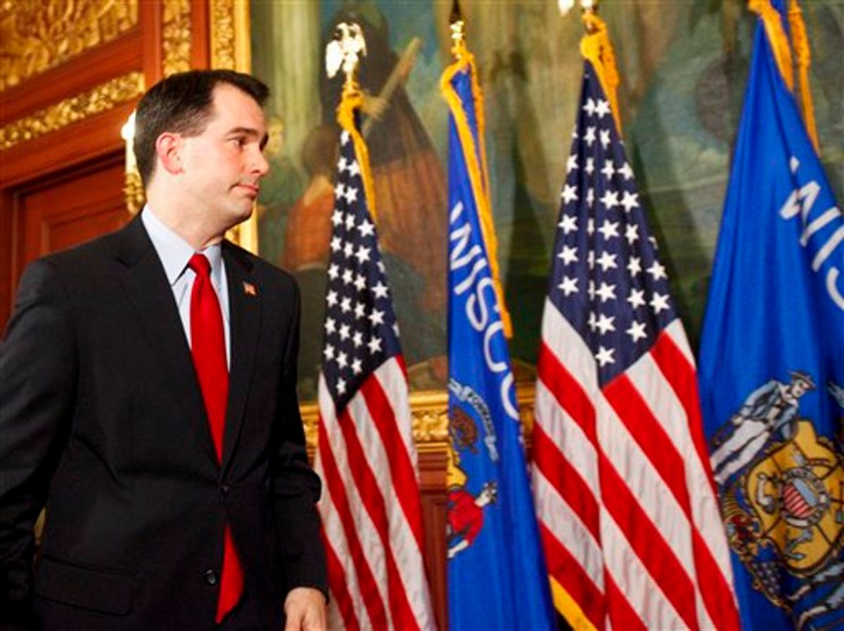 Wisconsin Gov. Scott Walker walks away after talking to the media at the state Capitol in Madison, Wis., Monday, Feb. 21, 2011. Opponents to the governor's bill to eliminate collective bargaining rights for many state workers are in the 7th day of protests at the Capitol. (AP Photo/Andy Manis) (AP)