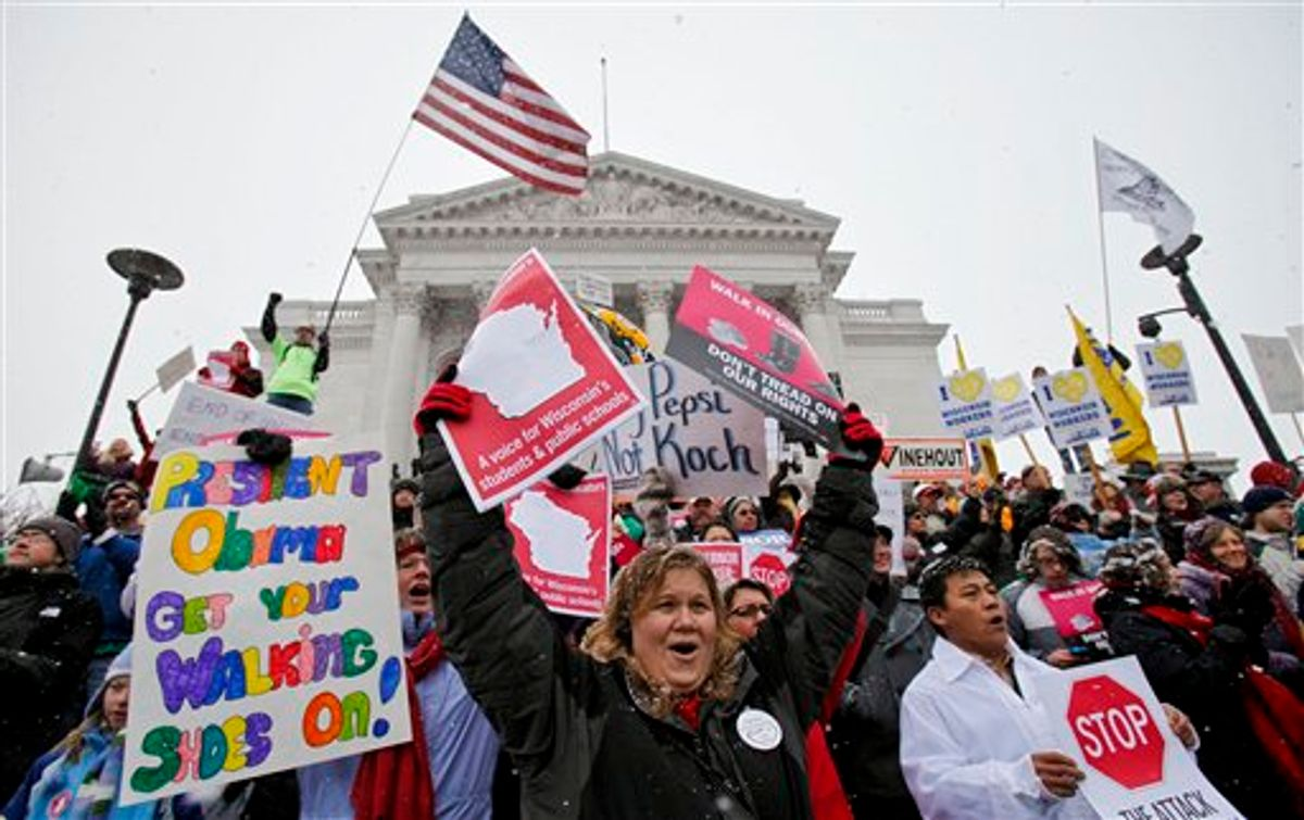 Teacher Kristen Henningfeld, center, of Elk Mound, Wis., protests on the steps of the state Capitol in Madison, Wis., Saturday, Feb. 26, 2011. Protests to the governor's bill to eliminate collective bargaining rights for many state workers are in their 12th day. (AP Photo/Andy Manis) (AP)