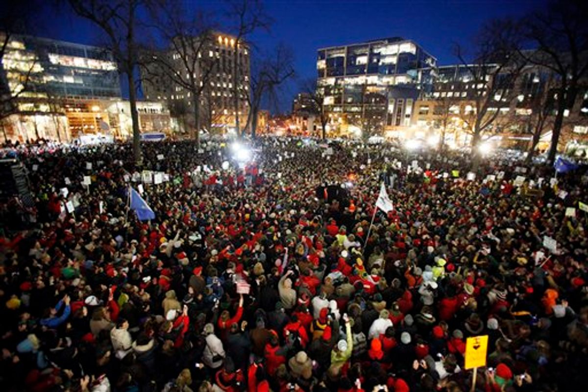 The Rev. Jesse Jackson, near right center of photo, takes the stage amidst tens of thousands of protesters gathered at the State Capitol in Madison, Wis., Friday,  Feb. 18, 2011.   (AP Photo/Wisconsin State Journal, Michael P. King) (AP)