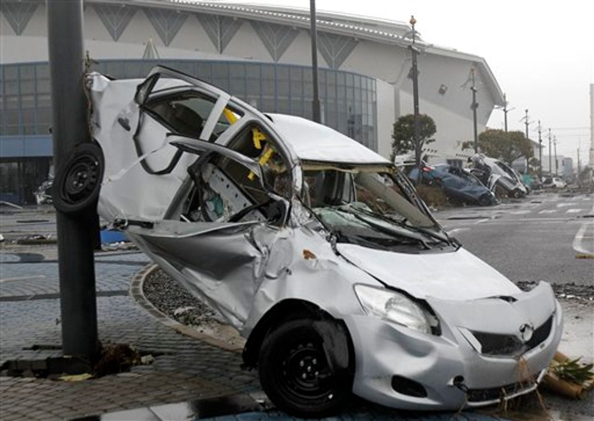 Wreckage of Toyota Yaris compact sedans, export model for North America destroyed by the March 11 earthquake and tsunami, remain at a Sendai port, Japan, Tuesday, March 15, 2011. (AP Photo/Koji Sasahara) (AP)