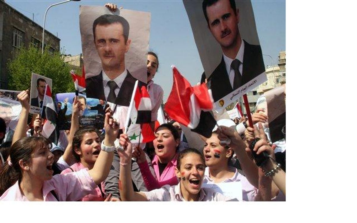 Young pro-Syrian President Bashar Assad protesters, shout pro-Assad slogans as they demonstrate to show their support for him.