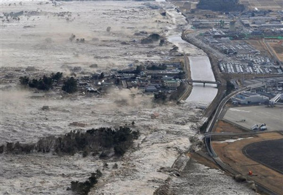 CORRECT YEAR - Earthquake-triggered tsumanis sweep shores along Iwanuma in northern Japan on Friday March 11, 2011. The magnitude 8.9 earthquake slammed Japan's eastern coast Friday, unleashing a 13-foot (4-meter) tsunami that swept boats, cars, buildings and tons of debris miles inland.  (AP Photo/Kyodo News) JAPAN OUT, MANDATORY CREDIT, FOR COMMERCIAL USE ONLY IN NORTH AMERICA (AP)