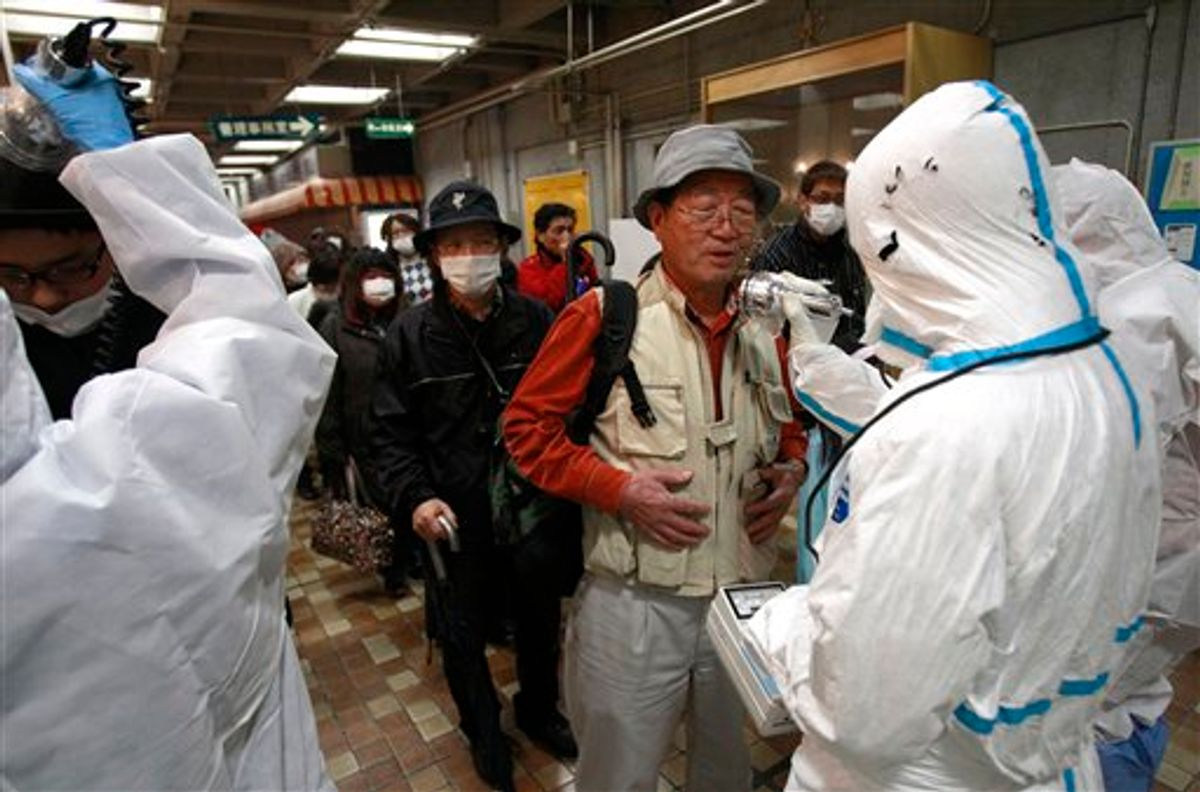 An evacuee is screened for radiation exposure at a testing center Tuesday, March 15, 2011, in Koriyama city, Fukushima prefecture, Japan, after a nuclear power plant on the coast of the prefecture was damaged by Friday's earthquake. (AP Photo/Wally Santana) (AP)