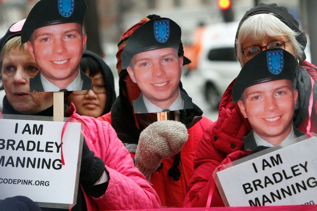 CodePink activists, including Danielle Greene, right, hold signs in support of U.S. Army Pfc. Bradley Manning, the alleged leaker of documents to WikiLeaks, who is currently jailed, Monday, Jan. 17, 2011, during a demonstration outside FBI headquarters in Washington. (AP Photo/Jacquelyn Martin) (AP)