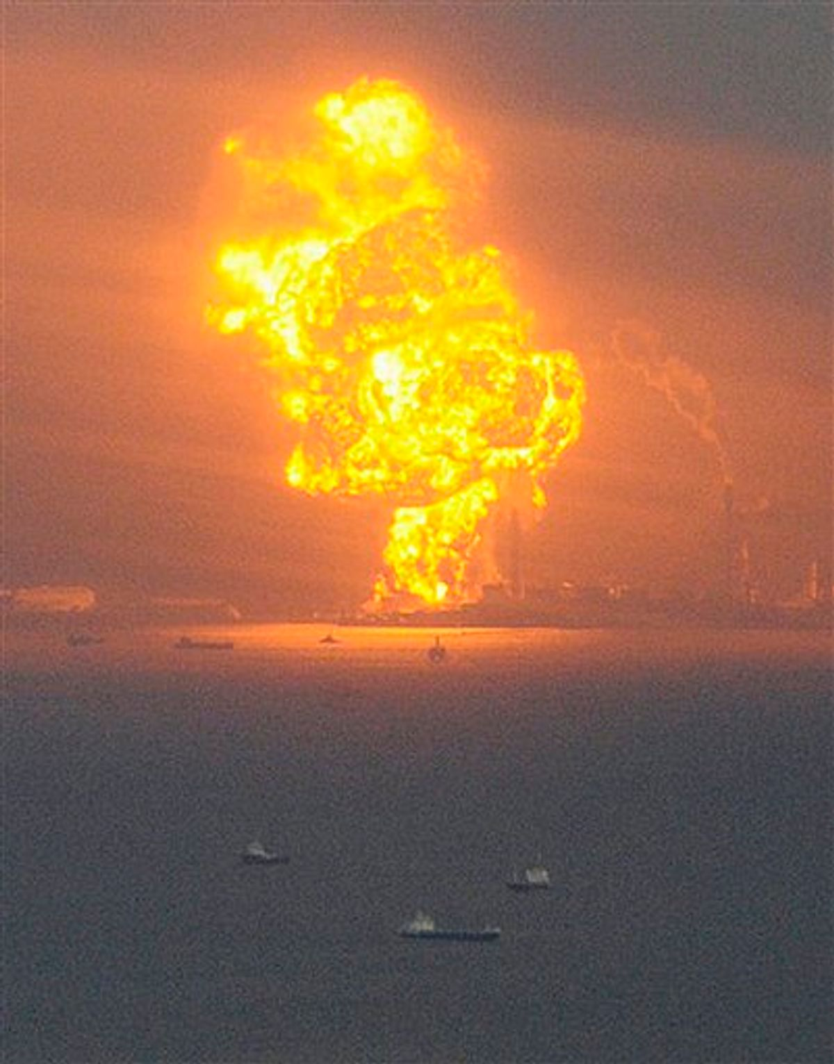 Flames rise from an oil refinery after a powerful earthquake in Ichihara, Chiba prefecture (state), Japan, Friday, March 11, 2011. The largest earthquake in Japan's recorded history slammed the eastern coast Friday. (AP Photo/Kyodo News) JAPAN OUT, MANDATORY CREDIT, FOR COMMERCIAL USE ONLY IN NORTH AMERICA (AP)