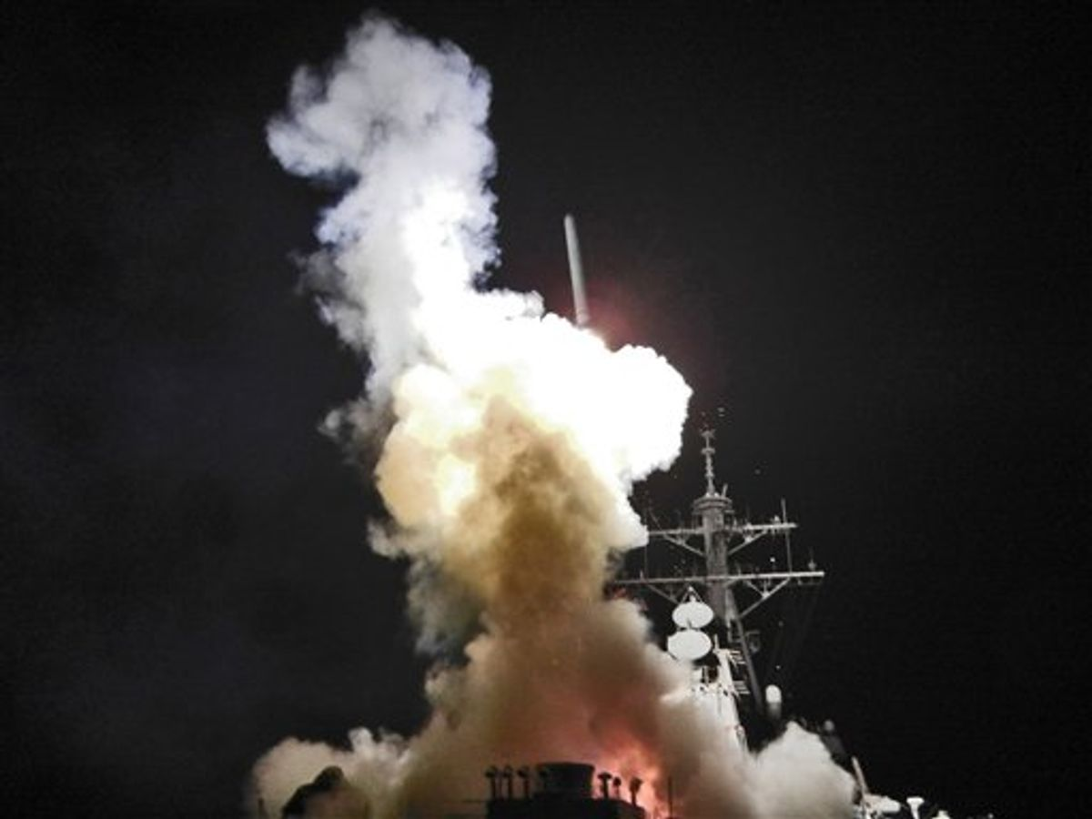 This Saturday, March 19, 2011 photo provided by the U.S. Navy shows the Arleigh Burke-class guided-missile destroyer USS Barry (DDG 52) as it launches a Tomahawk missile in support of Operation Odyssey Dawn from the Mediterranean Sea . The U.S. fired more than 100 cruise missiles from the sea while French fighter jets targeted Moammar Gadhafi's forces from the air on Saturday, launching the broadest international military effort since the Iraq war in support of an uprising that had seemed on the verge of defeat. (AP Photo/U.S. Navy, Fireman Roderick Eubanks) (AP)