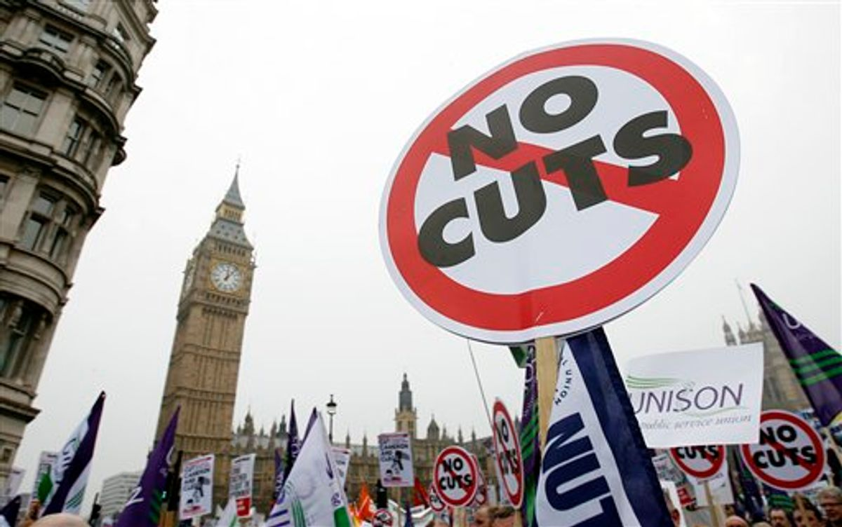 Back-dropped by Big Ben, demonstrators against the coalition government's spending cuts march in London, Saturday, March 26, 2011.  Tens of thousands of mostly peaceful demonstrators streamed into central London on Saturday to march against government budget cuts, with a small breakaway group smashing its way into a bank, breaking windows and spray painting logos on the walls . (AP Photo/Akira Suemori) (AP)