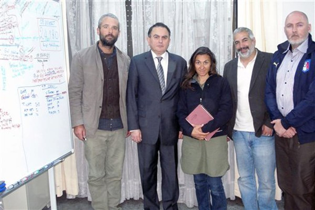 In this March 21, 2011 photo released by the  Turkish Ministry of Foreign Affairs, from left to right, New York Times journalists Tyler Hicks, T Ambassdor Levent Sahinkaya, Lynsey Addario  Anthony Shadid and Stephen Farrell  pose at the Turkish Embassy in Tripoli, Libya. The four New York Times journalists who had been held by Libya crossed into Tunisia on Monday after being released. (AP Photo/Turkish Ministry of Foreign Affairs) (AP)