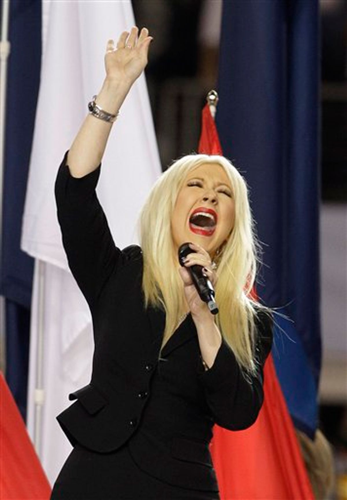 Christina Aguilera sings the national anthem before the NFL football Super Bowl XLV game between withe Green Bay Packers  and the Pittsburgh Steelers Sunday, Feb. 6, 2011, in Arlington, Texas. (AP Photo/Charlie Krupa)   (AP)