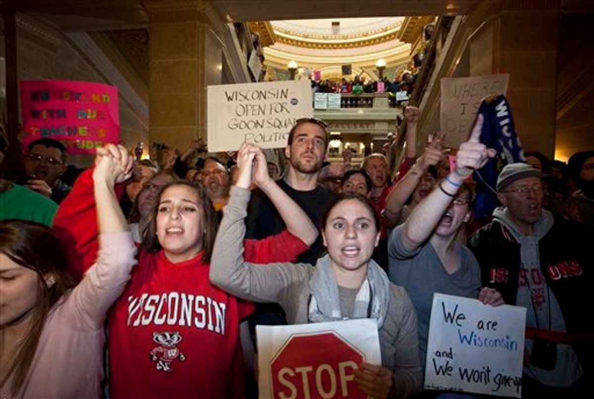 Protesters yell outside Wisconsin Gov. Scott Walker offivce after a ceremonial bill signing ceremony Friday, March 11, 2011, in Madison, Wis. (AP Photo/Morry Gash) (AP)