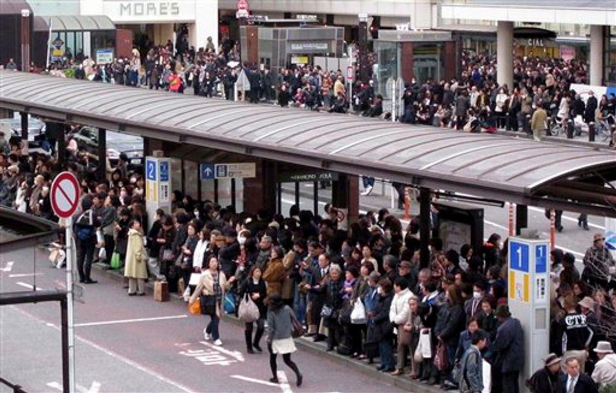 CORRECT COUNTRY CODE IN HEADER FIELD - Commuters wait in a long queue at a bus terminal outside Yokohama railway station in Yokohama, southwest of Tokyo, following a strong earthquake hit eastern Japan on Friday, March 11, 2011. (AP Photo/Shuji Kajiyama) (AP)