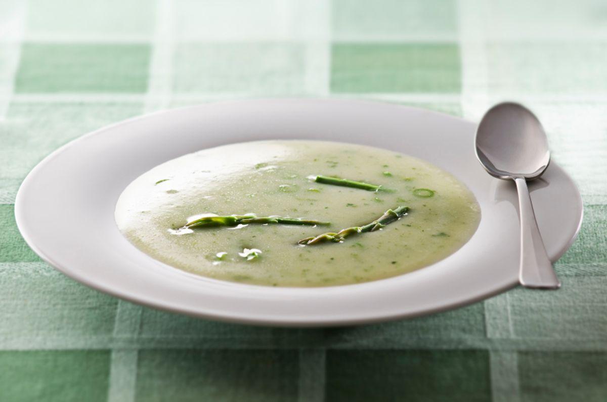 Fresh asparagus soup in white plate close up (Dusan Zidar)