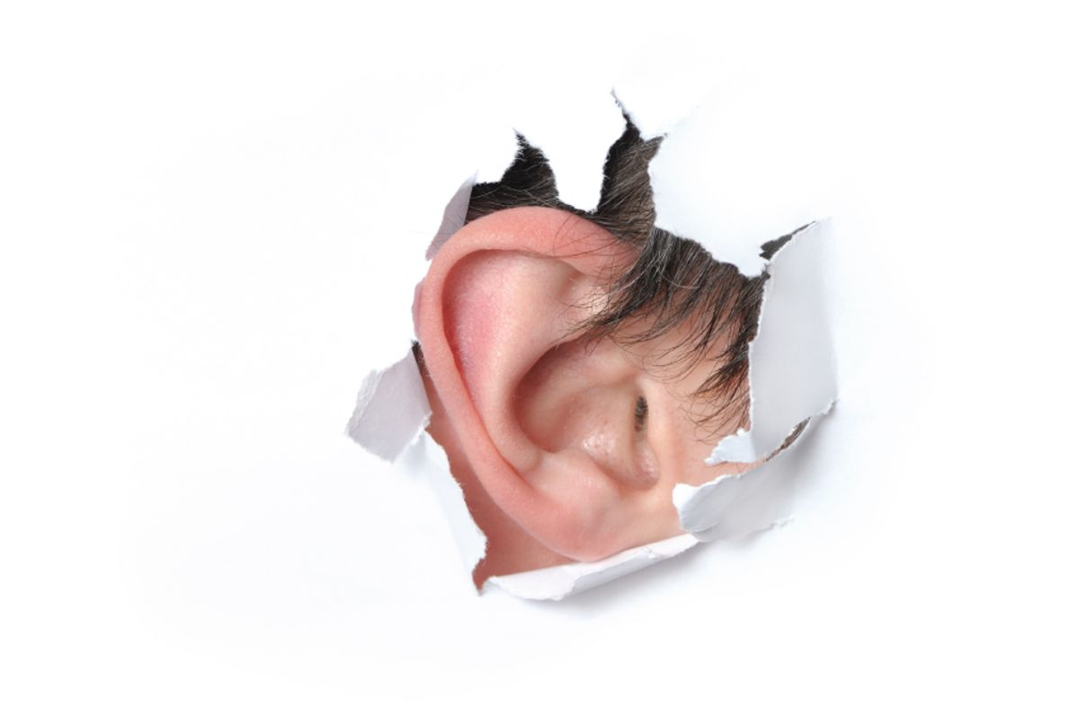 Ear in the hole of a paper (Igor Kovalchuk)