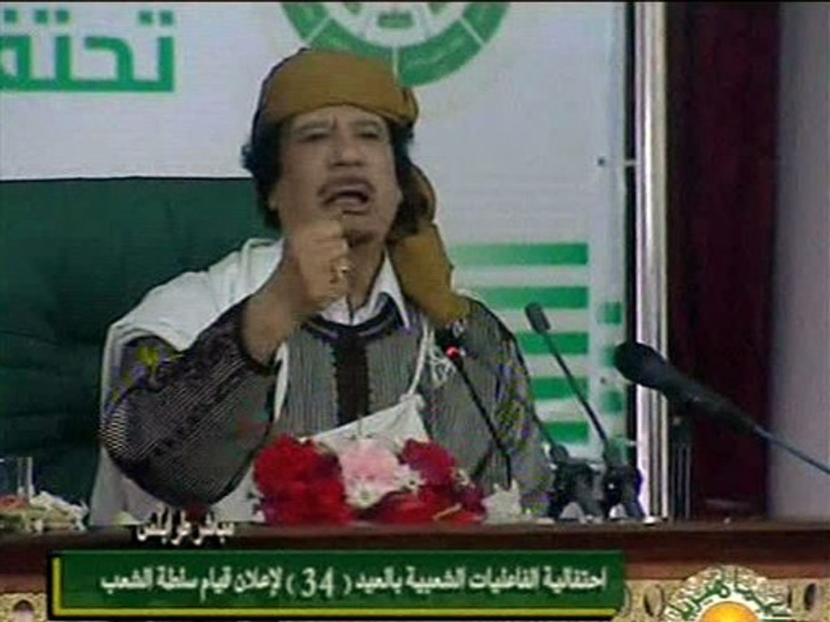 This video image taken from Libyan state television broadcast Wednesday March 2, 2011 shows Libyan leader Moammar Gadhafi addressing supporters and journalists in Tripoli, Libya. (AP Photo/Libyan state television via APTN)   LIBYA OUT, TV OUT (AP)