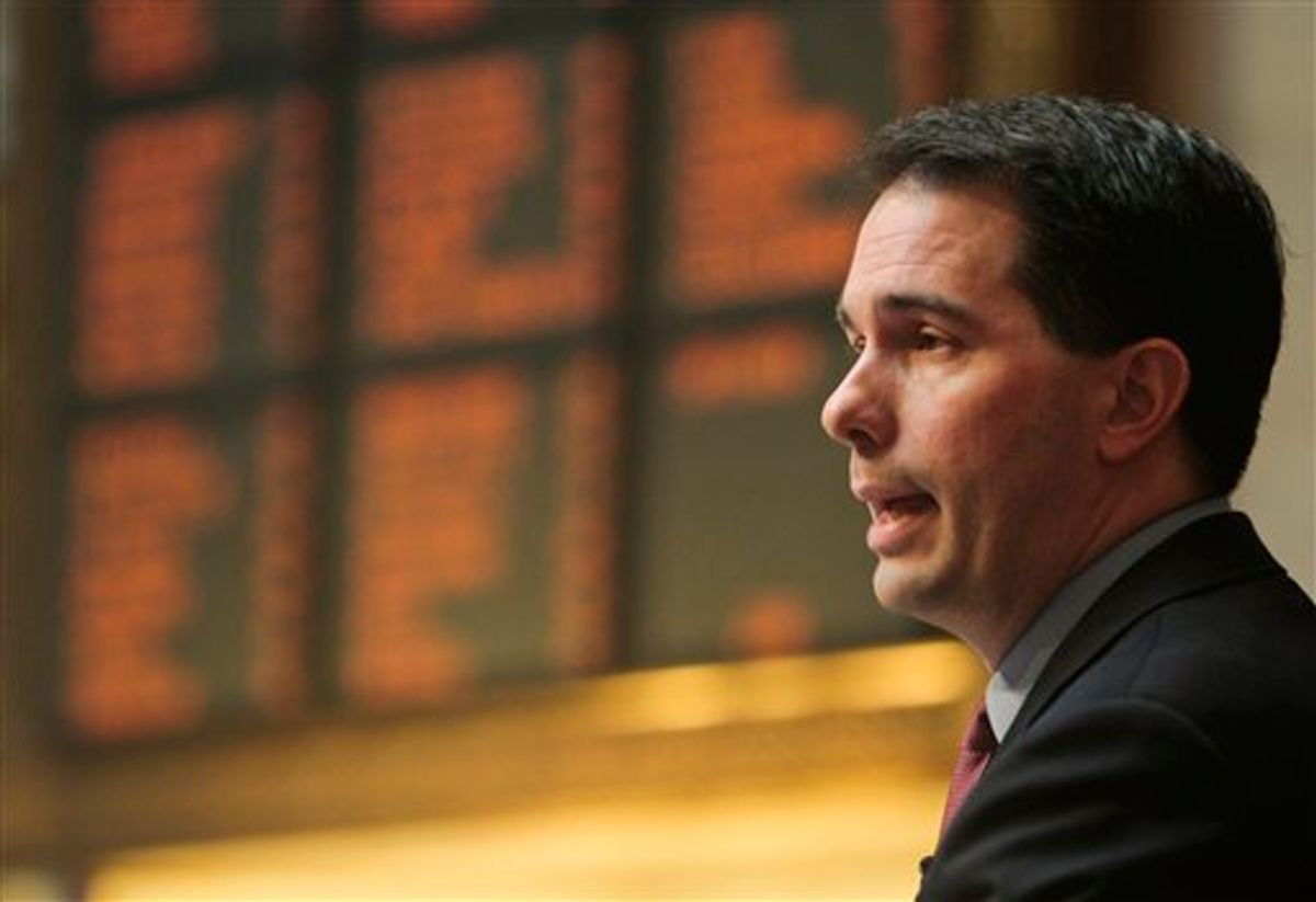 Wisconsin Gov. Scott Walker addresses a joint session of the Legislature at the state Capitol in Madison, Wis., Tuesday, March 1, 2011. Opponents to the governor's bill to eliminate collective bargaining rights for many state workers have been protesting the governor's budget for 14 days at the Capitol. (AP Photo/Andy Manis) (AP)