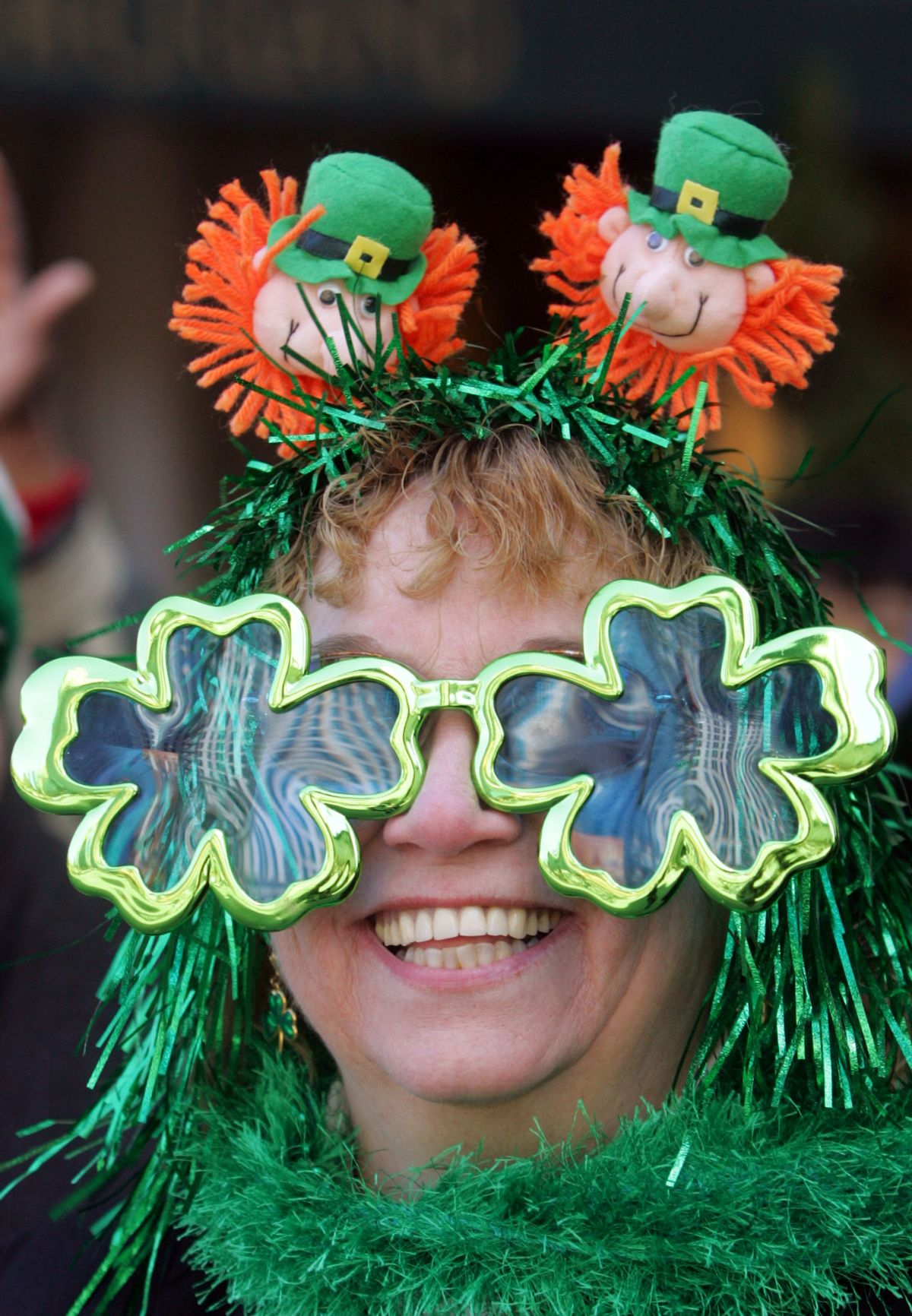 Geralyn Monahan-Jones, from Beacon, NY, greets participants of the annual St. Patrick's Day Parade on Fifth Avenue, Friday, March 17, 2006 in New York. This is the 245th year that St. Patrick's Day Parade has been held in New York City. (AP Photo/Dima Gavrysh) (AP)