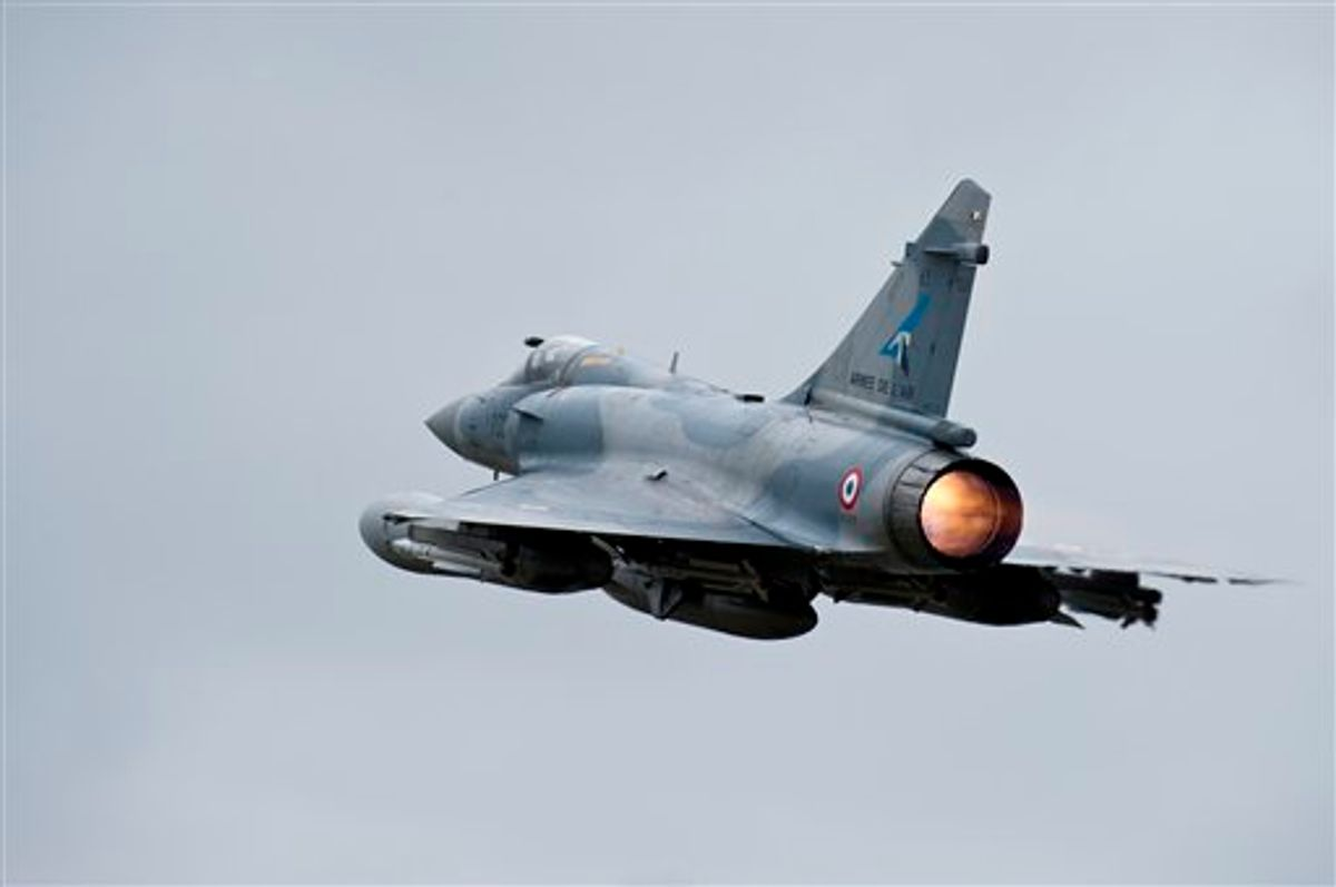 This photo provided by the French Army shows French Mirage 2000 jet fighter taking off for Libya at the military base of Dijon, central France, Saturday, March 19, 2011. Top officials from the United States, Europe and the Arab world have launched immediate military action to protect civilians as Libyan leader Moammar Gadhafi's forces attacked the heart of the country's rebel uprising. The Mirages 2000 are operating in Libya. (AP Photo/ Anthony Jeuland; SIRPA AIR) NO SALES (AP)